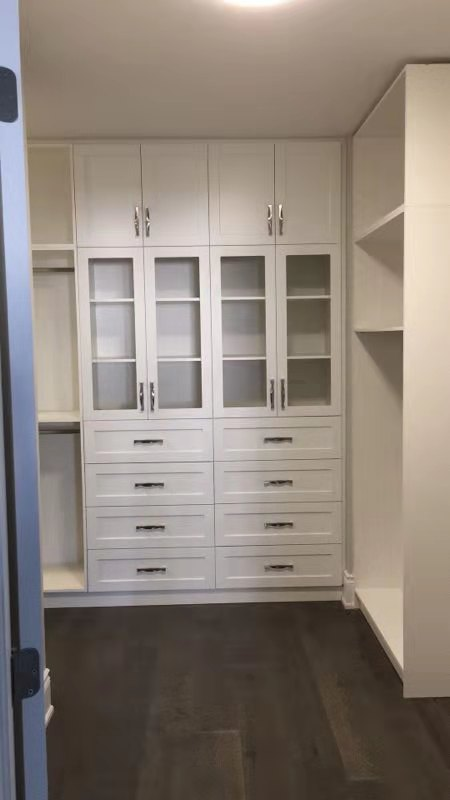 White closet with door for showcase